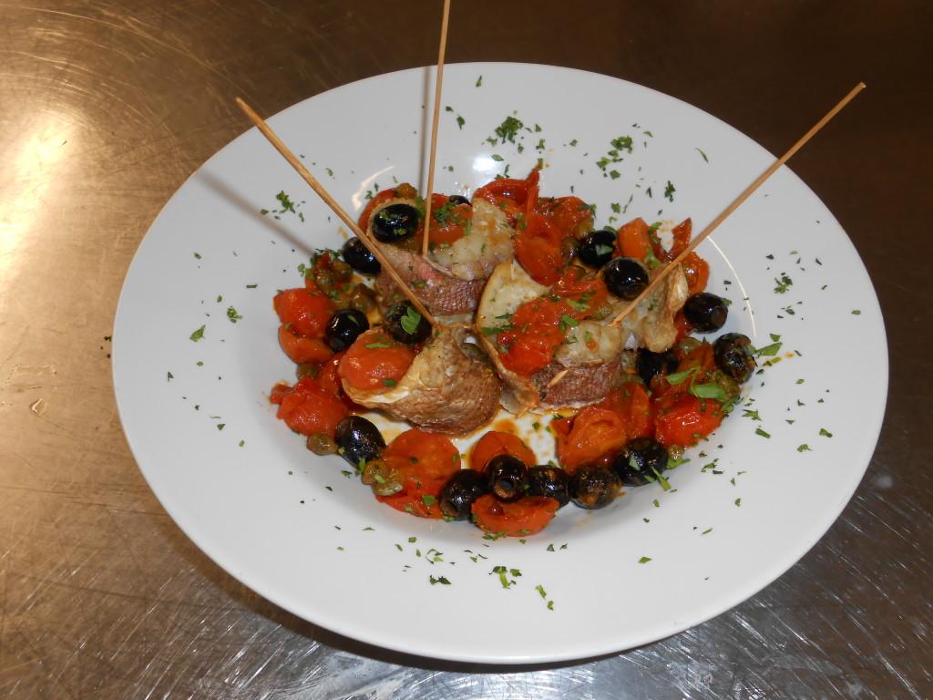 Branzino alle olive e pomodorini